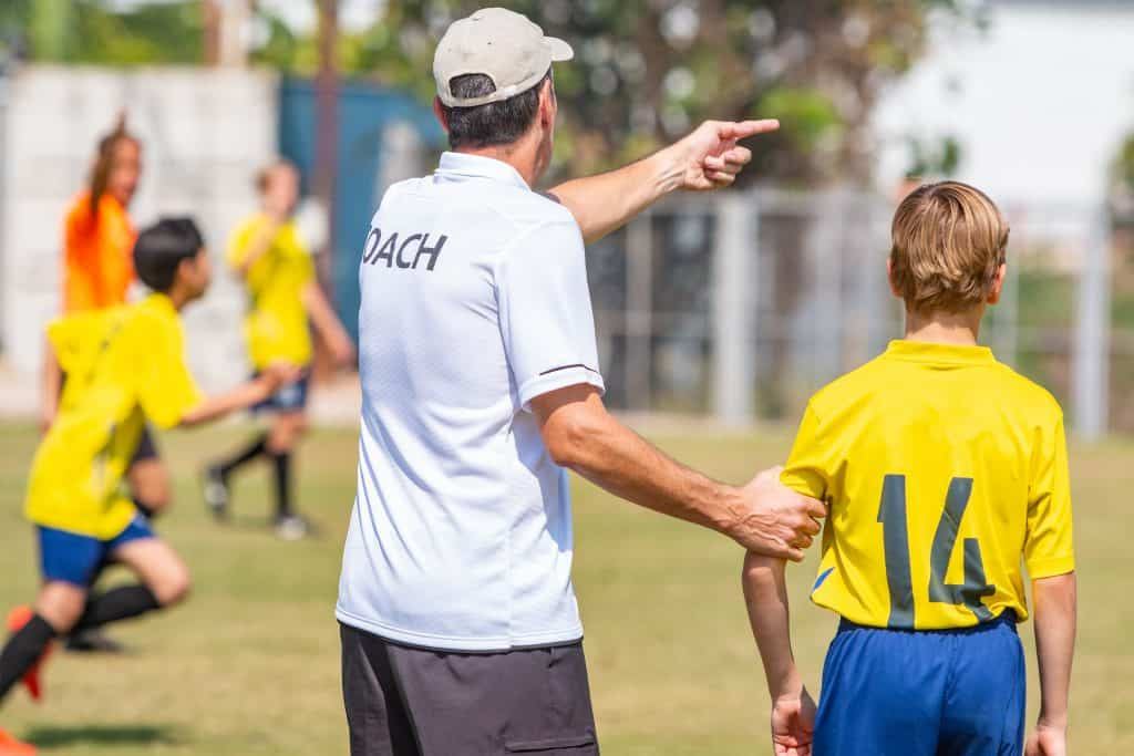 soccer coach and player