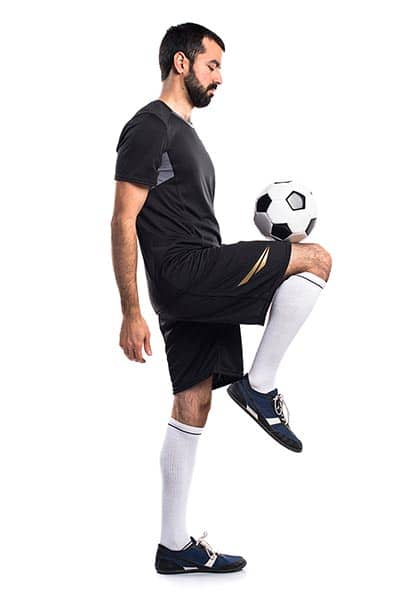 Juggling a soccer ball on a knee