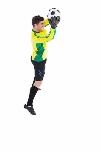goalkeeper in a jump with the ball in hands