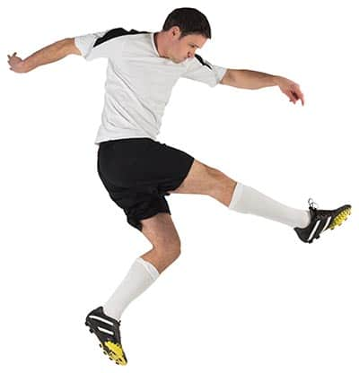 profile of soccer player after striking the ball