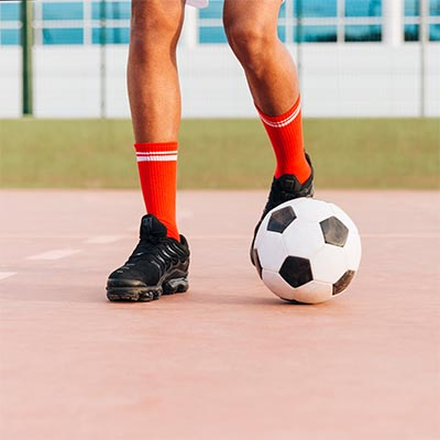 soccer player dribbling with outside of foot