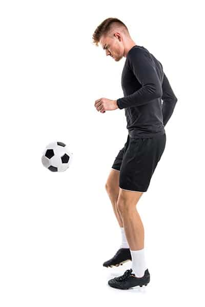soccer player juggling the ball