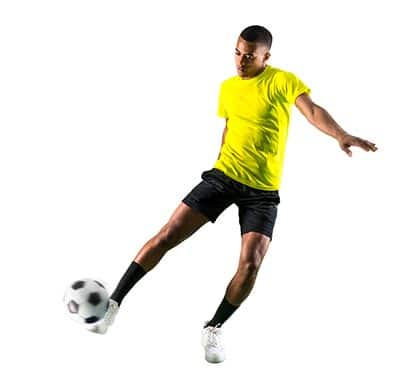 soccer player streching to strike the ball