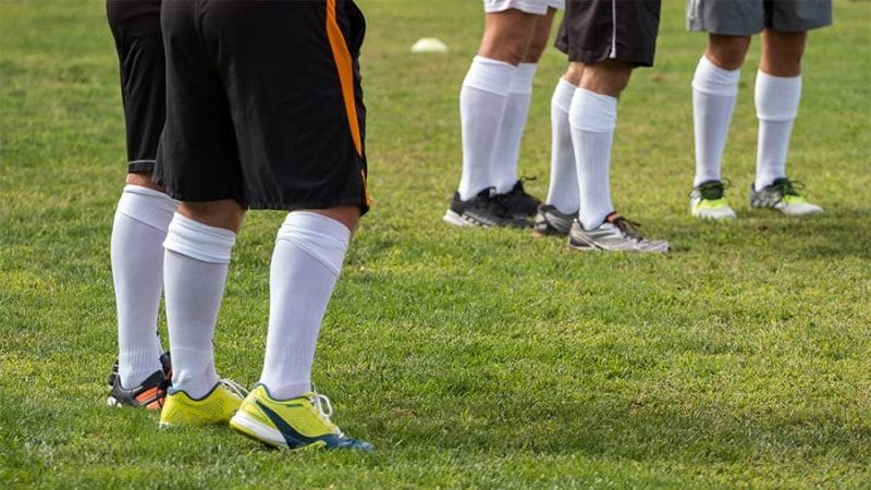 soccer players legs shorts socks and cleats