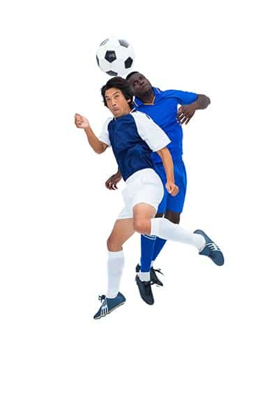two soccer player jumping for a header