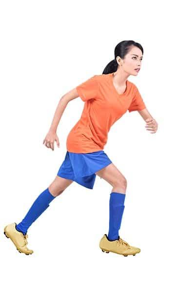 woman soccer player running