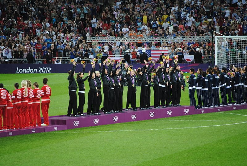 Soccer at the Olympics US Womens lifting trophy and medals