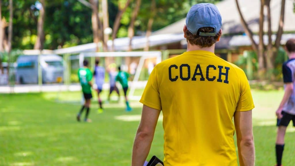 Soccer coach on sidelines with questions